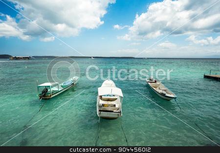 Small boats on nusa penida beach, Bali Indonesia stock photo, romantic Small boats on nusa penida beach, Bali Indonesia with blue sky, tranquil scene by Artush