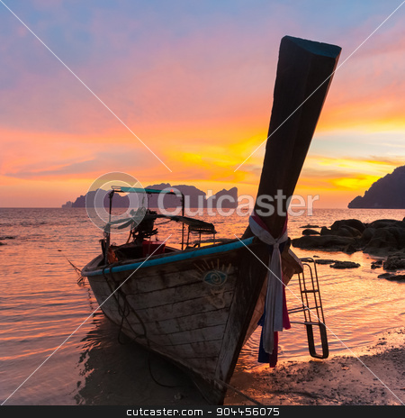 Traditional wooden longtail boat on beach in sunset, Thailand. stock photo, Traditional thai wooden longtail boat on beach of Phi-Phi Don island in sunset. Silhouette of famous Phi Phi Lee island in background. Thailand, Krabi province. by kasto