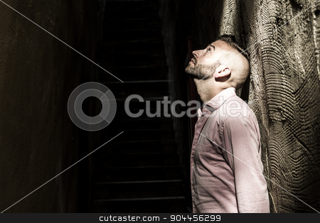Portrait of young, depressed man in pain stock photo, A Portrait of young, depressed man in pain by Louis-Paul St-Onge