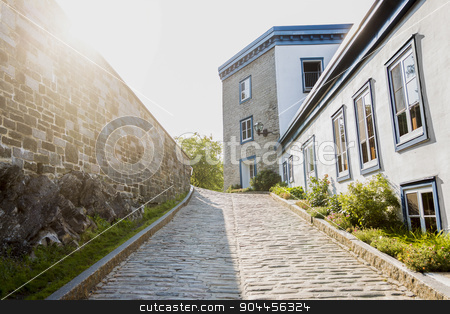 Street of old Quebec  stock photo, A Street of old Quebec city with sun on the left side by Louis-Paul St-Onge