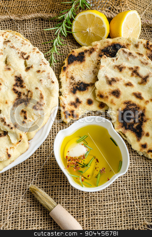 Indian bread naan stock photo, Indian bread with rosemary, garlic and olive oil by Peteer