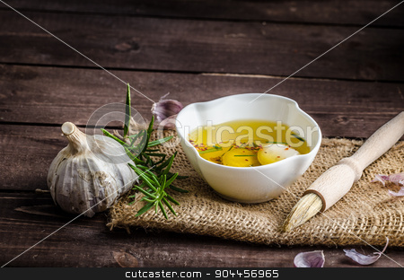 Seasoned olive oil, garlic and rosemary stock photo, Seasoned olive oil, garlic and rosemary, place for text advertisment by Peteer