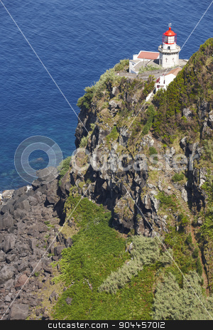 Lighthouse, cliff and atlantic ocean in Ponta do Arnel, Azores stock photo, Lighthouse, cliff and atlantic ocean in Ponta do Arnel, Azores. Vertical by ABBPhoto