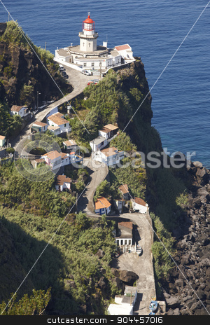 Lighthouse, road and atlantic ocean in Ponta do Arnel, Azores stock photo, Lighthouse, road and atlantic ocean in Ponta do Arnel, Azores. Vertical by ABBPhoto