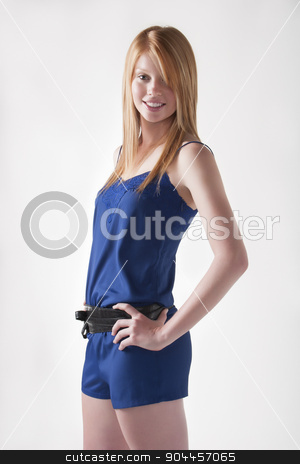 Model in blue jumpsuit stock photo, Cute model posing in a blue jumpsuit with a black belt by JRstock