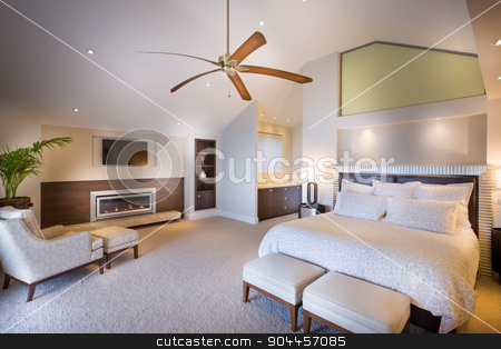 Spacious bedroom at daytime stock photo, Spacious double bed bedroom with a wooden fan photographed in daytime light by JRstock