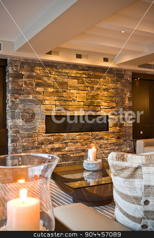 A detail of a cozy living room stock photo, Burning decorative candles in a cozy living room by JRstock