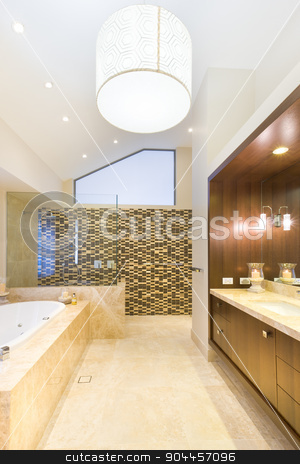Fashionable bathroom with marble floor stock photo, Fashionable bathroom with a shower, tub and a marble floor by JRstock