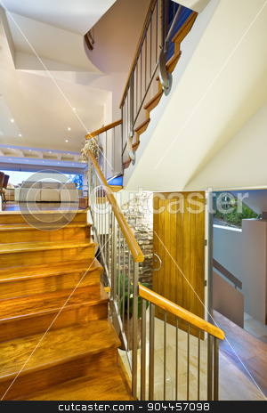 Stairway in a beautiful modern house stock photo, Wooden stairway in a beautiful modern house by JRstock