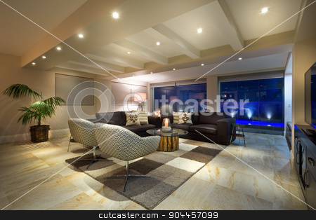 Luxurious living room stock photo, Luxurious living room  with big windows, couple of sofas and armchairs by JRstock
