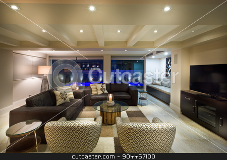 Beautiful living room with a tv set stock photo, Beautiful living room with big windows, couple of sofas and armchairs and a tv set by JRstock