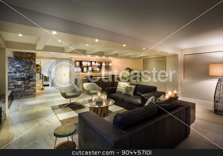 Modern underground living room stock photo, Modern underground living room with couple of sofas, armchairs and a bar by JRstock