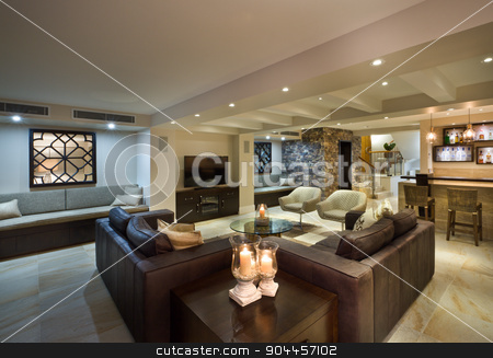 Modern living room with a bar stock photo, Modern living room with leather sofas and a bar by JRstock