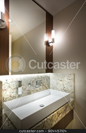 A detail of a modern bathroom stock photo, A wide rectangular sink and a mirror in a modern bathroom by JRstock