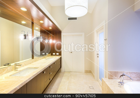 Beautiful bathroom with marble floor stock photo, Beautiful bathroom with marble floor, wooden details and big mirrors by JRstock