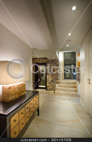 Hallway in a luxurious house stock photo, Long hallway in a big luxurious house by JRstock