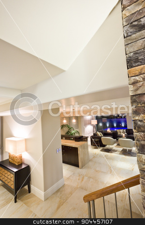 Far away view of a cozy living room stock photo, Far away view of a cozy living room in a big luxurious house by JRstock