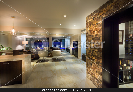 Big living room with a wine cellar stock photo, Big living room with a wine cellar in a luxurious house by JRstock