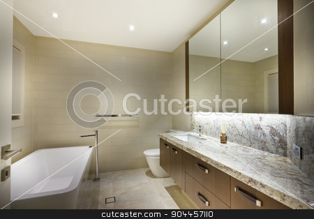 Exclusive minimalistic bathroom stock photo, Exclusive minimalistic bathroom with a strict-shaped tub by JRstock