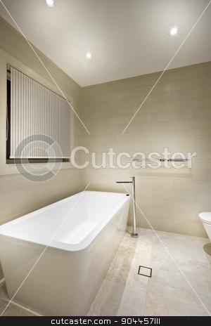 A modern tub in a minimalistic bathroom stock photo, A modern tub in a minimalistic, pastel - coloured bathroom by JRstock