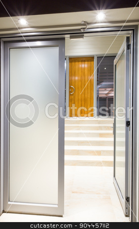 Doors leading to a staircase stock photo, A matte open door, leading to a staircase in a house by JRstock