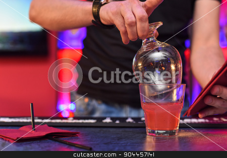 Making cocktail stock photo, Closeup photo in a bar where barmen makes cocktail by olinchuk