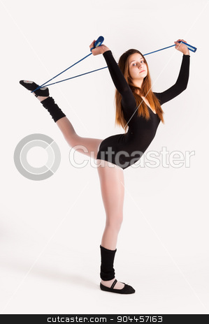 fitness woman making balance exercise stock photo, Young cute woman in gymnast suit show athletic skill at white background by Aikon
