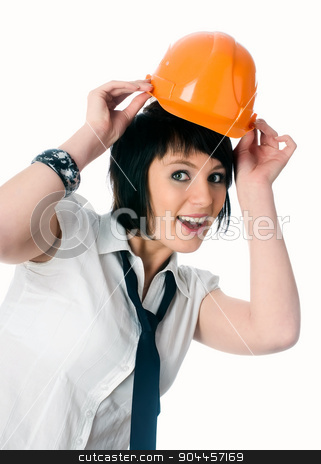 Funny girl in helmet stock photo, Young joyful businesswoman in protective helmet isolated on white by Aikon