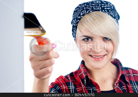 Young woman with paintbrush stock photo, Charming blonde painter in a red shirt by Aikon