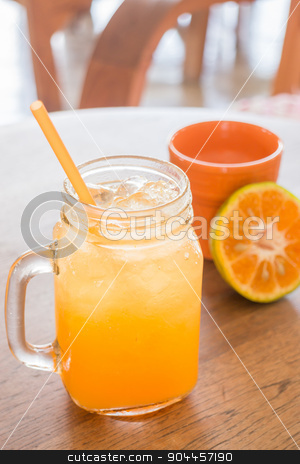 Fresh orange juice serving on wooden table stock photo, Fresh orange juice serving on wooden table, stock photo by nalinratphi