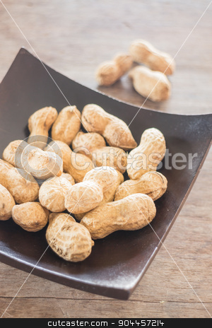 Salted peanuts on wooden bowl stock photo, Salted peanuts on wooden bow, stock photo by nalinratphi
