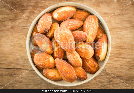 Almond grain roast salt on weathered wooden table stock photo, Almond grain roast salt on weathered wooden table, stock photo by nalinratphi