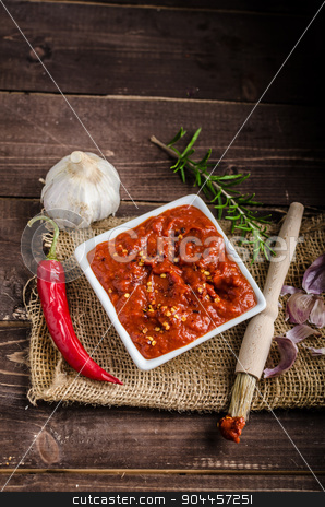Very spicy tomato sauce for grill stock photo, Very spicy tomato sauce with pieces of chilli and garlic, herbs by Peteer
