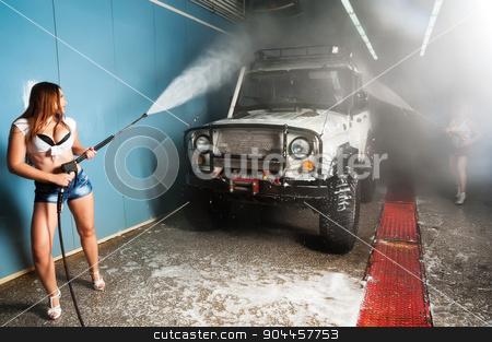 Sexy woman washing car stock photo, Pretty young woman washing extreme terrain car by Aikon