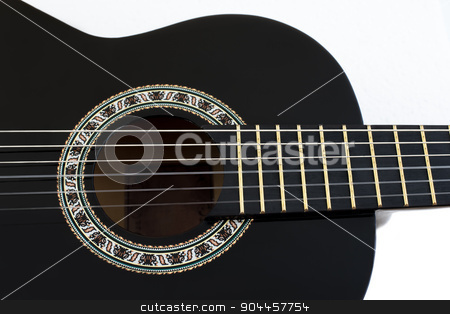 Detail of Classical Acoustic Guitar Isolated on a White Backgrou stock photo, Detail of Black Wooden Classical Acoustic Guitar Isolated on a White Background by Karol Czinege