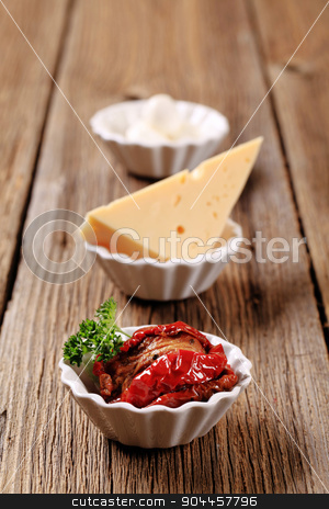 Appetizers stock photo, Sun dried tomatoes and two kinds of cheese by Digifoodstock