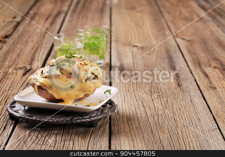 Double cheese twice baked potato  stock photo, Double cheese twice baked potato sprinkled with parsley by Digifoodstock