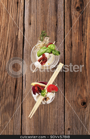 Cheese appetizers stock photo, Cheese appetizers in glass dishes - overhead by Digifoodstock