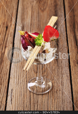 Cheese appetizer stock photo, Cheese appetizer in a wine glass and chopsticks by Digifoodstock
