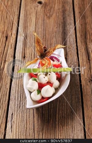 Caprese salad stock photo, Bowl of mozzarella cheese, tomato and basil by Digifoodstock