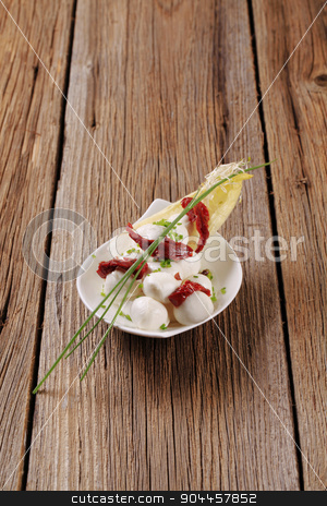 Cheese appetizer stock photo, Small balls of mozzarella cheese and sun dried tomato by Digifoodstock