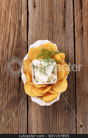 Corn chips and curd cheese stock photo, Bowl of corn chips and curd cheese by Digifoodstock