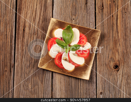 Caprese salad stock photo, Slices of fresh tomato and mozzarella cheese by Digifoodstock