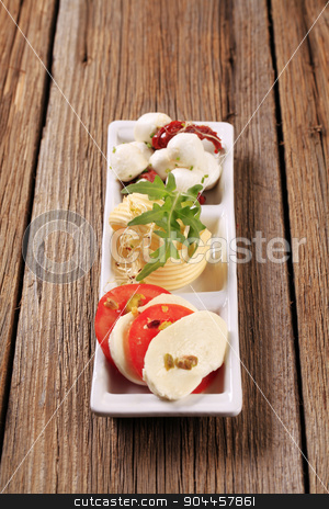 Vegetarian appetizer stock photo, Mozzarella cheese, fresh tomato and butter - closeup by Digifoodstock