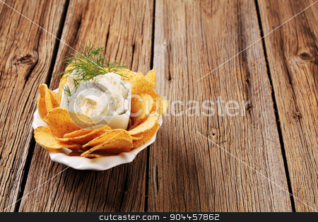 Corn chips and fresh cheese stock photo, Bowl of corn chips and fresh cheese by Digifoodstock