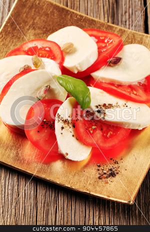 Caprese salad stock photo, Slices of fresh tomato and mozzarella cheese by Digifoodstock