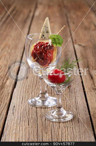 Appetizer stock photo, Dried tomato and slice of blue cheese in wine glass by Digifoodstock