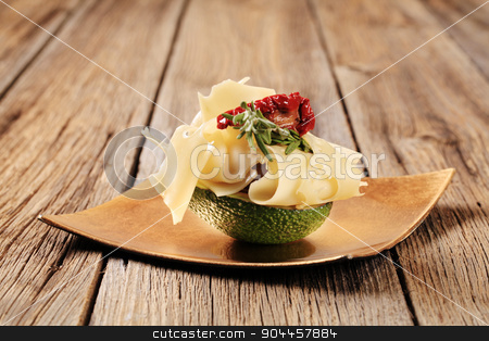 Avocado fruit and Swiss cheese stock photo, Avocado fruit and slices of Swiss cheese by Digifoodstock