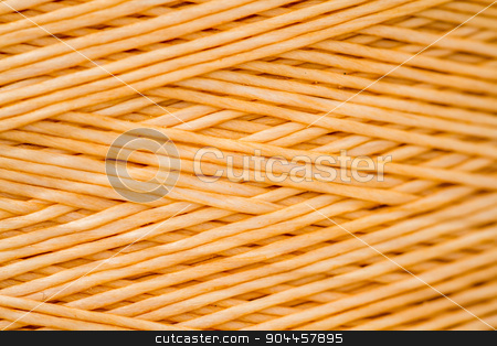 Close up of a Spool of Synthetic Orange Thread stock photo, Close up of a spool of synthetic orange thread by OZMedia