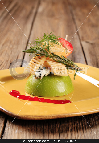 Cheese appetizer stock photo, Various types of cheese on an apple by Digifoodstock